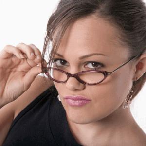 woman wearing blue light blocking glasses